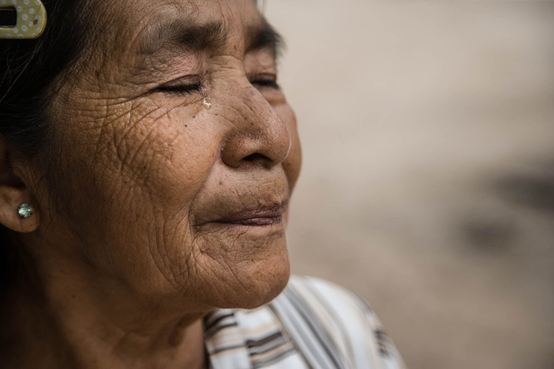Elderly-Mexican-woman-crying