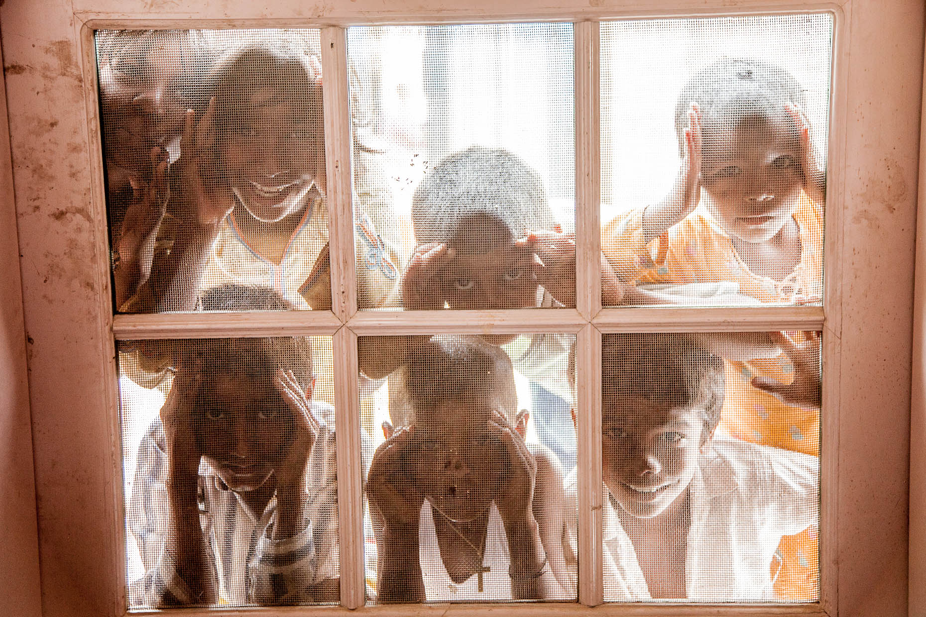 Children-in-Pakistan-look-in-window