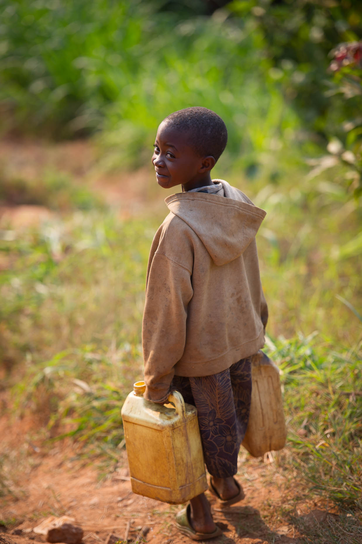 Girl-with-water-cans-Rwanda
