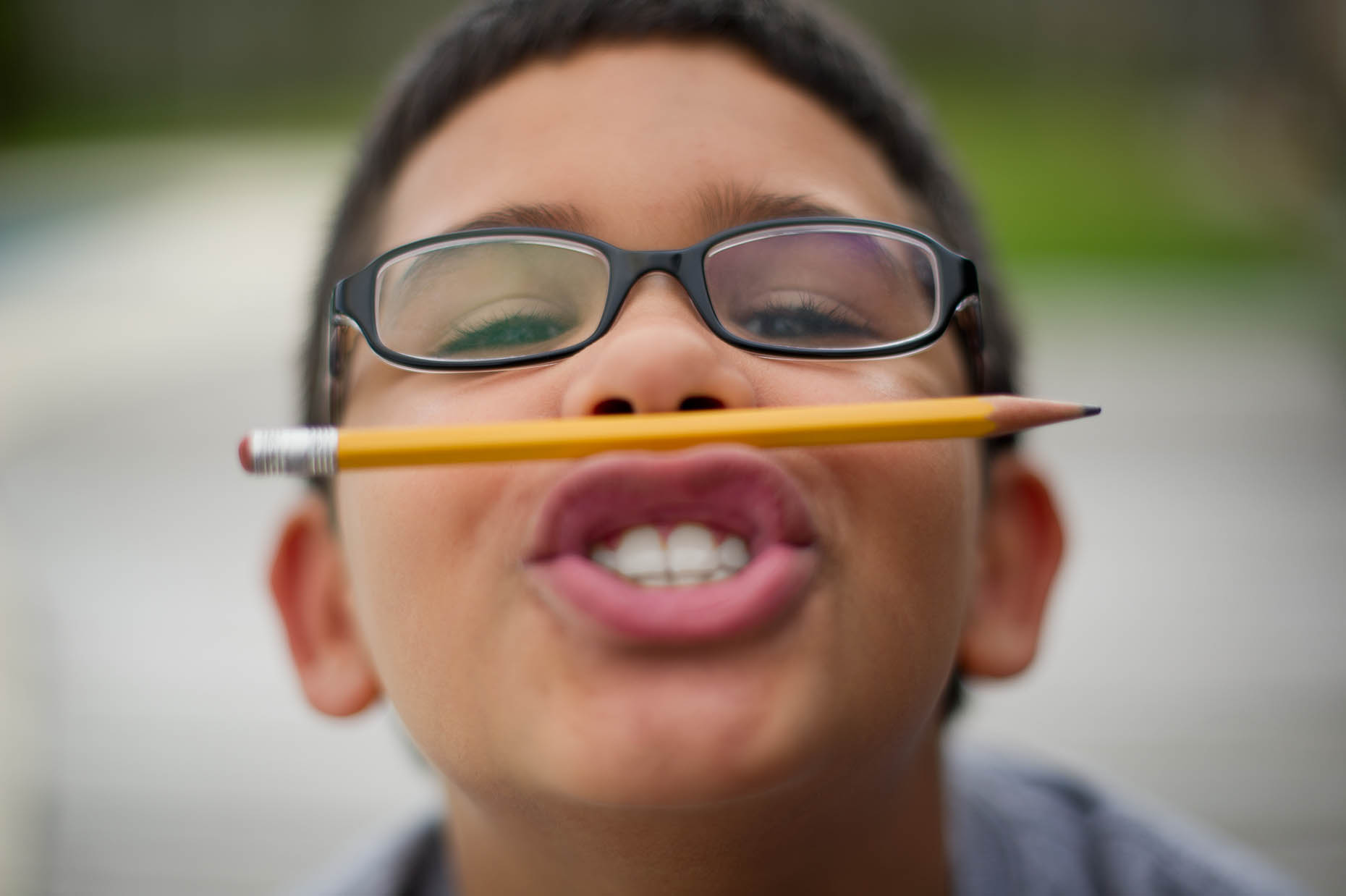 Hispanic-boy-with-pencil-on-lips