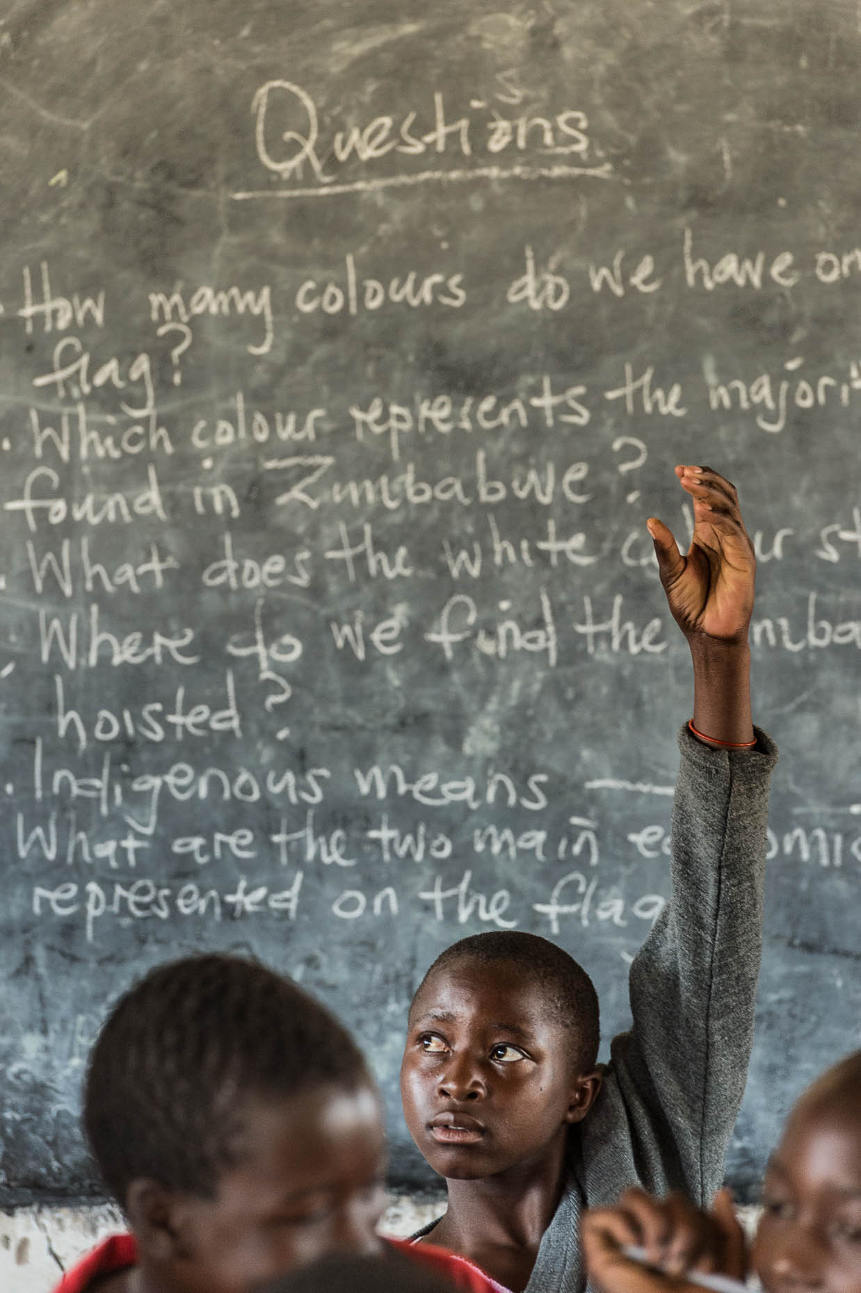 Female-raises-hand-in-classroom-Zimbabwe