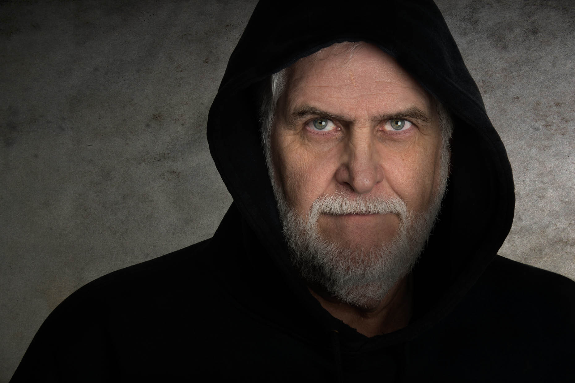 Portrait-older-man-with-hood