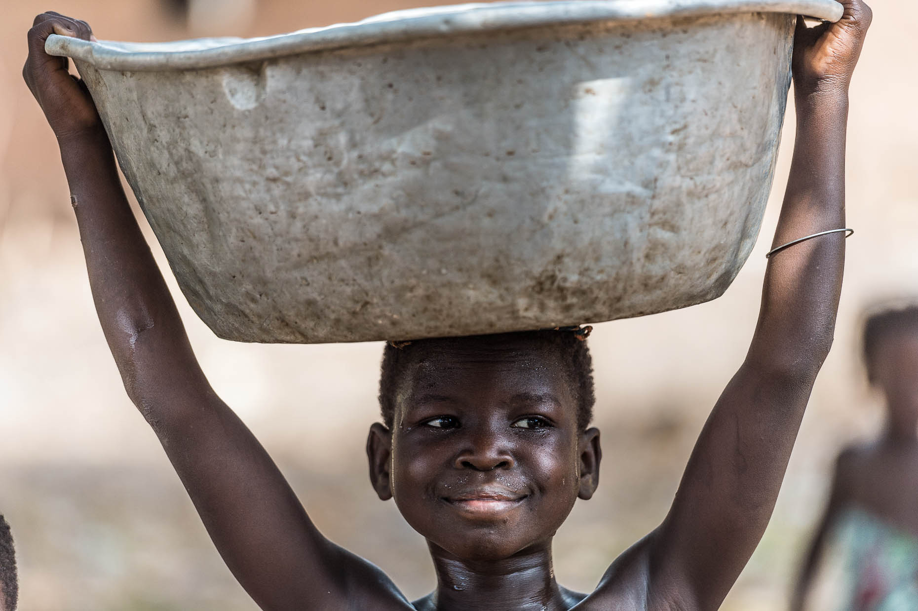 Girl-with-water-container-on-head-Ghana