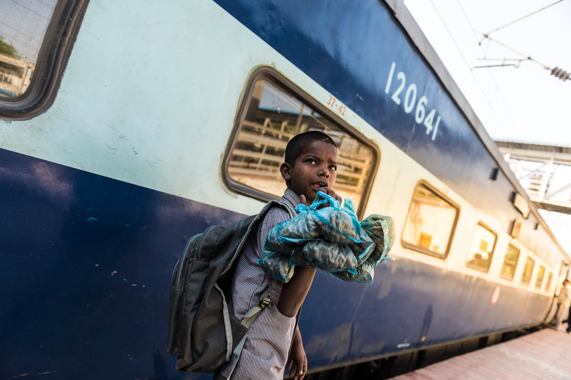 Street-child-at-train-at-train-station-India