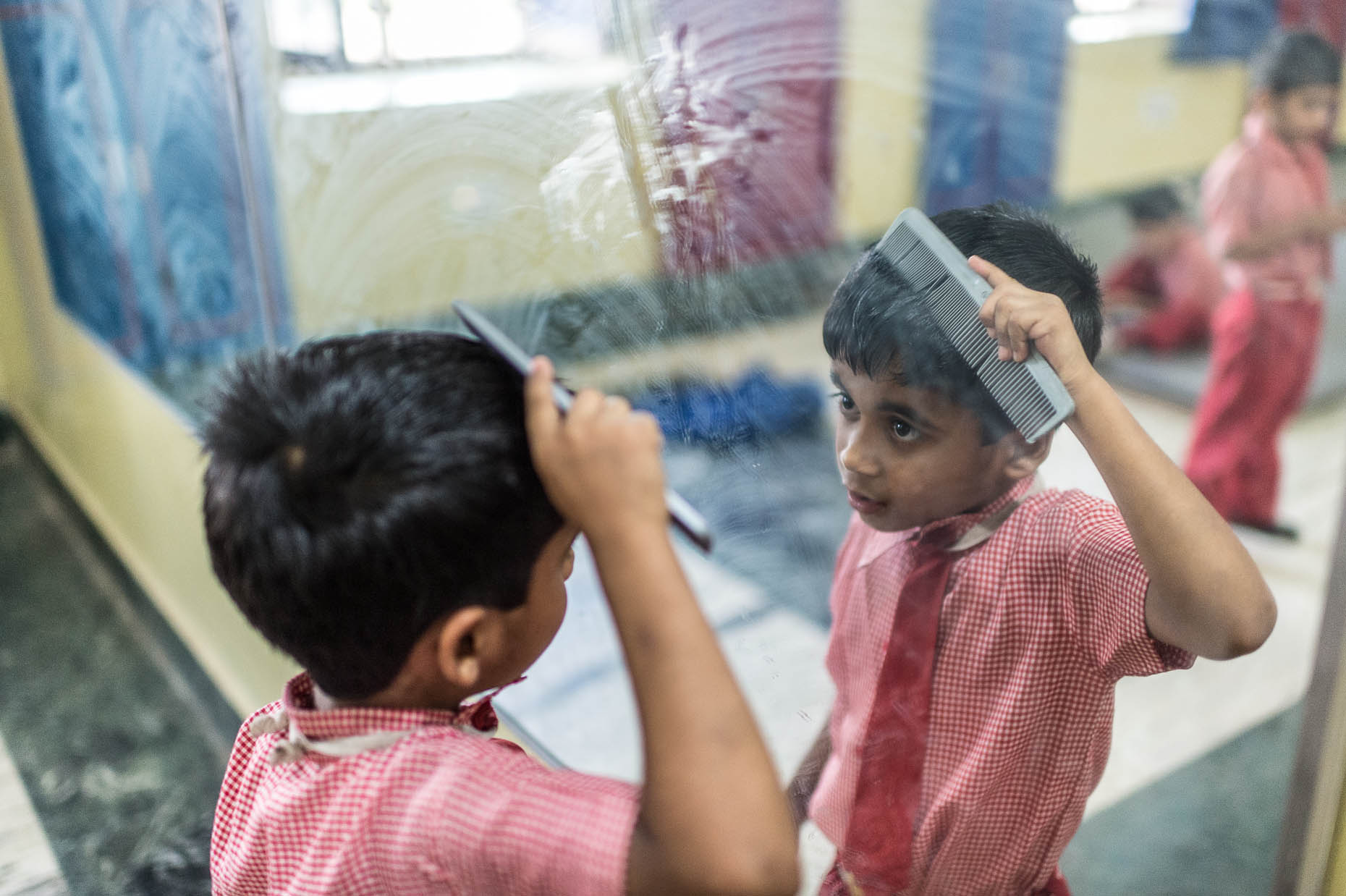 Orphan-combing-hair-India
