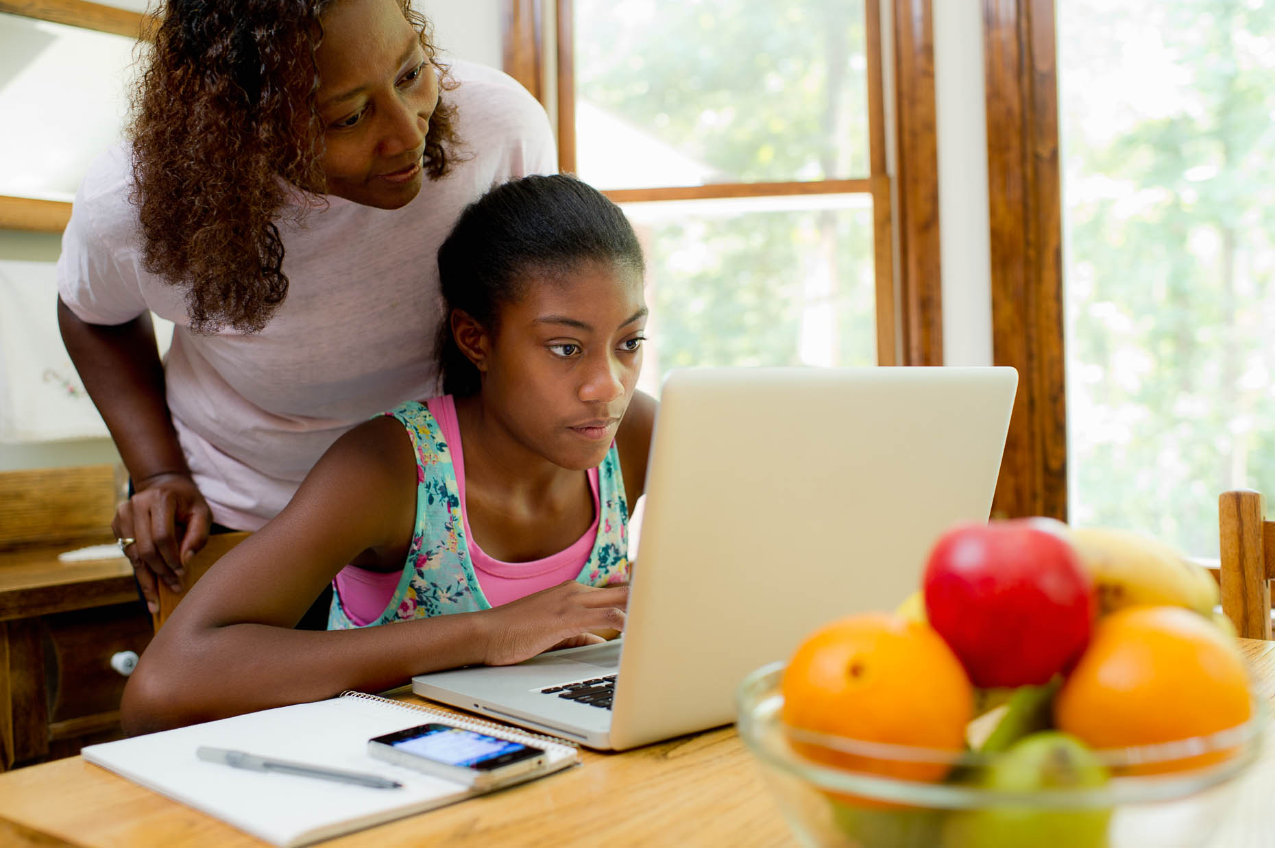 African-American-woman-helping-daughter-with-homework