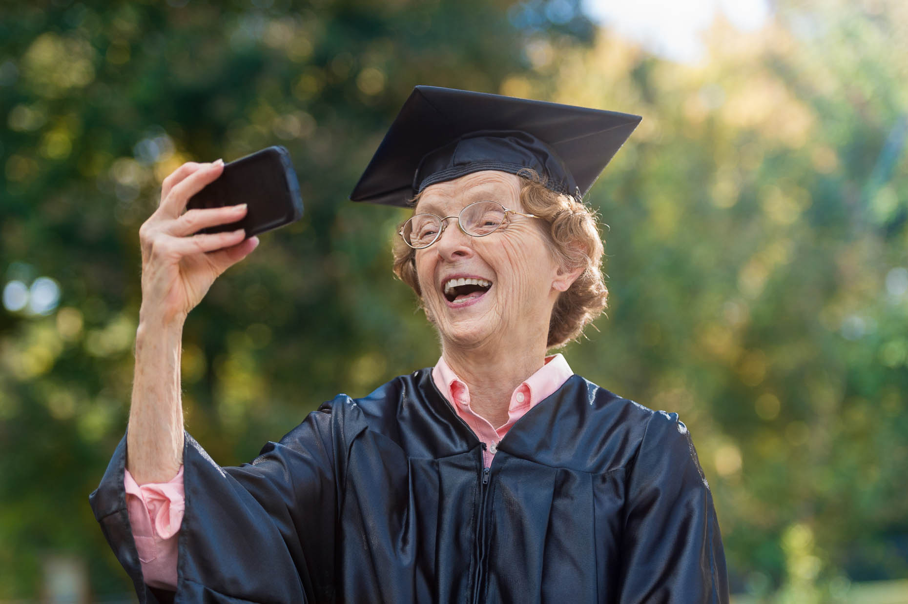 Elderly-woman-taking-graduation-selfie