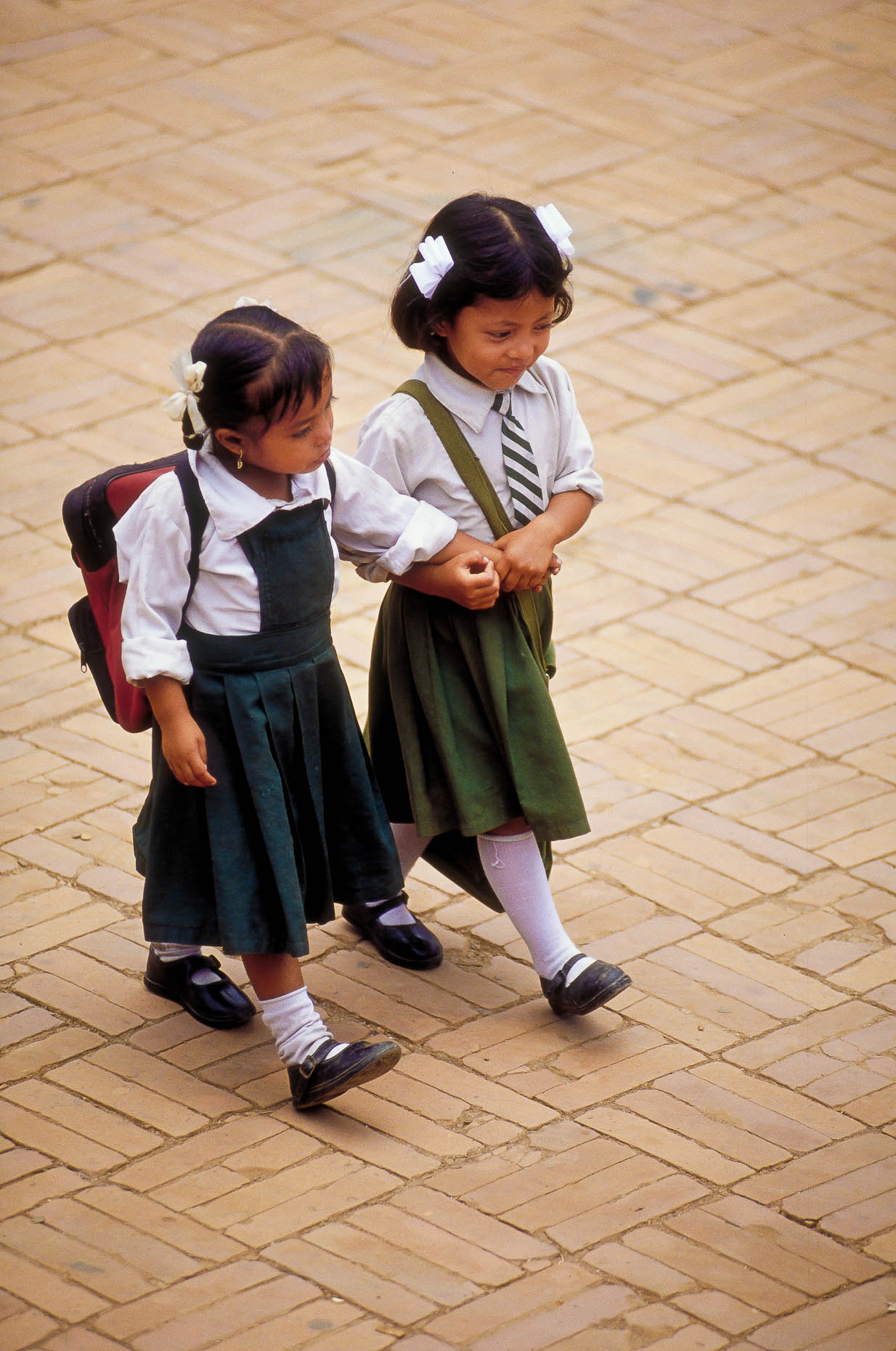 Schoolgirls-walking-hand-in-hand-Nepal